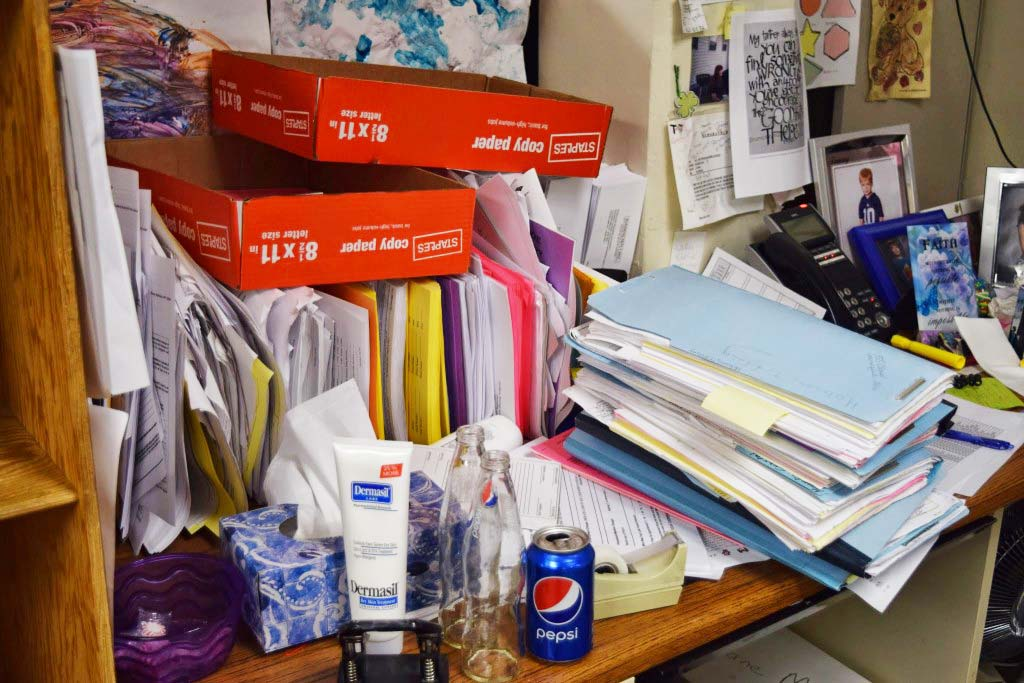Files-are-everywhere-at-the-Section-8-office-often-covering-employees-desks
